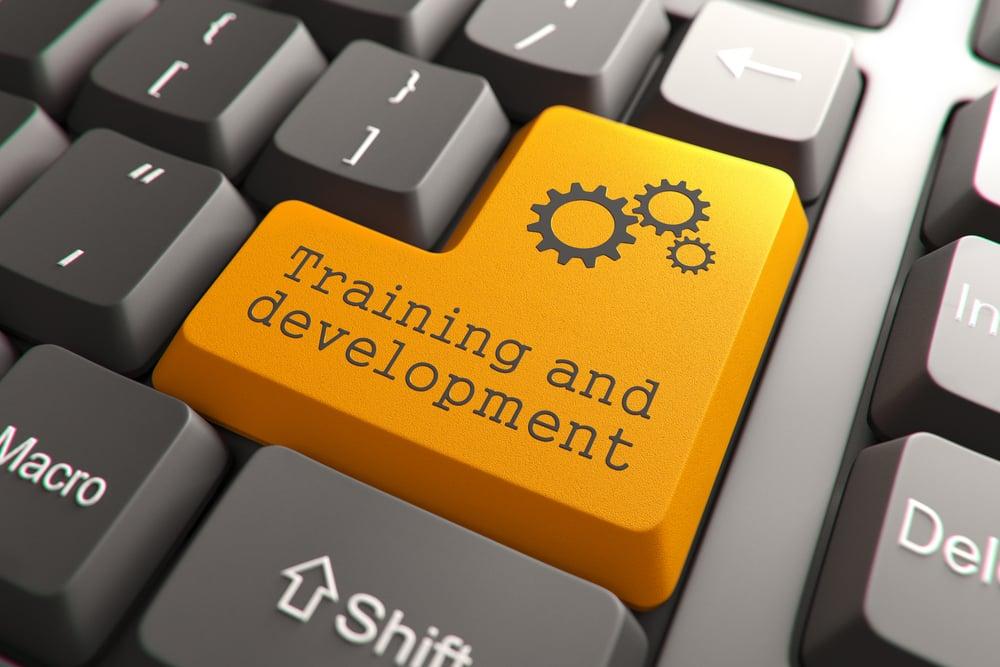 Training and Development, Orange Button on Computer Keyboard. Internet Concept.-1